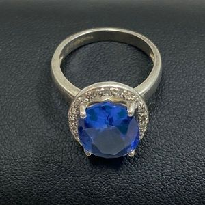 Silver Ring with Blue Faceted Setting